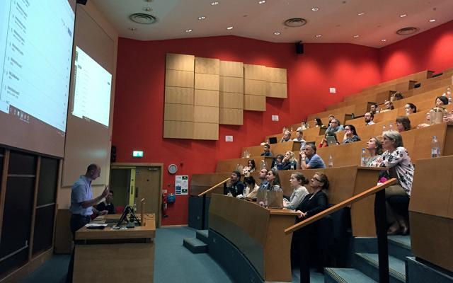 Staff demonstrating Canvas at the Martin Wood lecture theatre