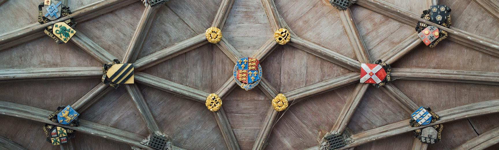 A gothic ceiling decoration at the University of Oxford with college coat of arms