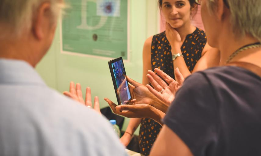 people discussing over a mobile device