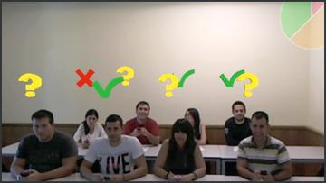 A class showing symbols giving feedback on the students' understanding (through an AR display)